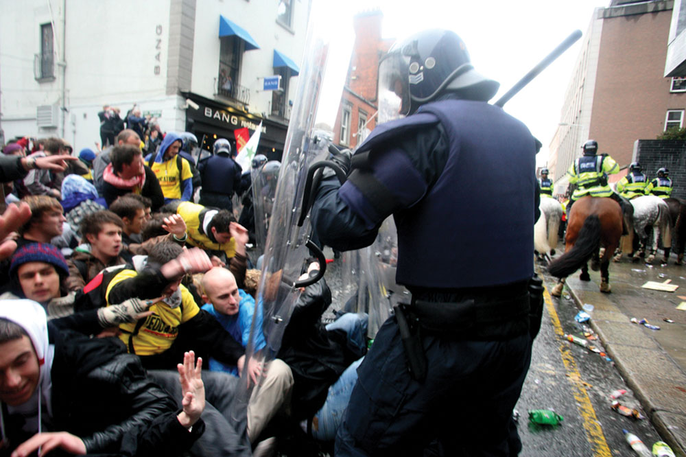 Riot police attacking students at protest against fees