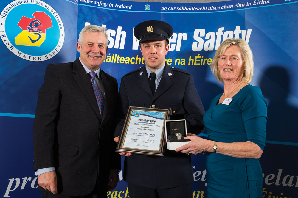 ABOVE: Garda Joe Hayes from Limerick receives his Seiko Just In Time award from Fergus O'Dowd TD Minister of State at the Department of Communications, Energy & Natural Resources and Environment, Community & Local Government and Breda Collins, IWS Chairman at the Irish Water Safety Association annual awards ceremony in Dublin Castle. Photo by David Branigan