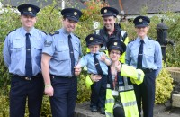 ABOVE (l-r): Garda Derek Rochford, Castleblayney Garda Station; Sergeant Alan Keane, Garda Community Relations Bureau; Ceejay McArdle, honorary Garda Sergeant, Castleblayney; Susan Brown, Ceejay's mother; Marcus McArdle, Ceejay's father; Garda Frances Merrick, Castleblayney Garda Station. PHOTO by Mick O'Neil