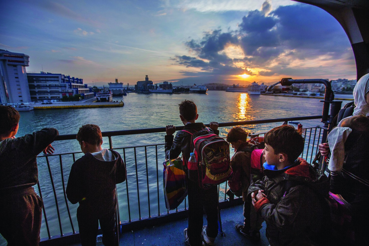 Syrian migrant children arrive to a new dawn as their ferry docks in athens. Pic:Mark Condren 9.10.2015