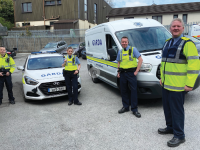 Gardaí Philip O'Neil, Siobhán Costello, Dáithí Ó'Floinn and Sergeant Mark Daly, pause for a moment before going out on a Covid-19 checkpoint near Mallow.
