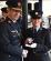 Garda Commissioner Drew Harris presenting the Gary Sheehan Memorial Medal to Garda Gemma Seagrave