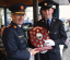 Garda Commissioner Drew Harris presenting the Fittest Class Award to Garda Maurice Dowling on behalf of Class 192E