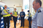 pictured: Gardaí pay close attention to a briefing in the Station before executing a search warrant in a local house.